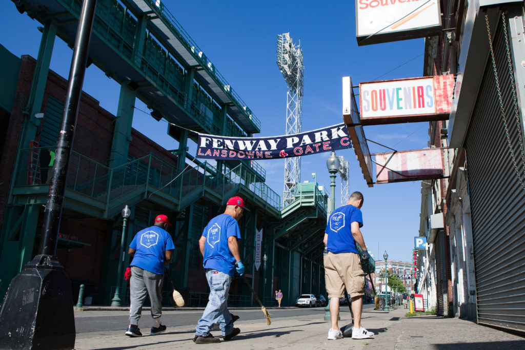 3 clean corners employees sweeping the streets in Fenway