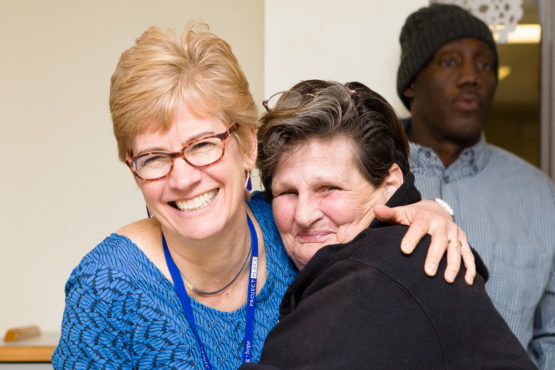 Suzanne and a client of Gatehouse hugging